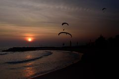 Paramotor flying and sunset Stock Photos