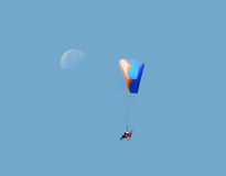 Paramotor glider and moon. A paramotor glider in blue sky with the moon Stock Image