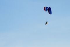 Paramotor, Parachute, Paraglide flying in the sunset sky Royalty Free Stock Images