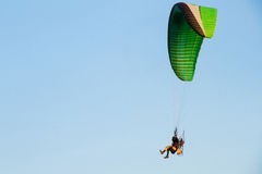 Paramotor, Parachute, Paraglide flying in the sunset sky Royalty Free Stock Image