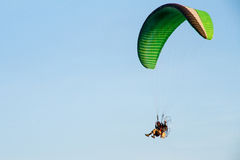 Paramotor, Parachute, Paraglide flying in the sunset sky Stock Photos