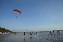 Paramotor on the sea. With people who can see it Stock Photo