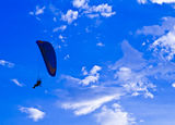 Paramotor silhouette in blue sky Stock Photo