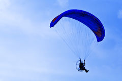 Paramotor silhouette in blue sky Stock Photos