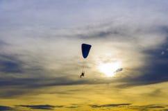 Paramotor in sunset sky Stock Photo