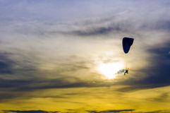 Paramotor in sunset sky Stock Photography
