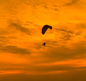 Paramotor in the sunset Stock Images