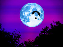 Paramotor and super moon in light night. The paramotor and super full moon in light night stock photos