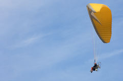 Paramotoring. Orange paramotoring with blue sky Royalty Free Stock Photo