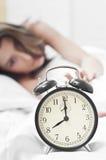 Parando o alarme da manhã Foto de Stock Royalty Free