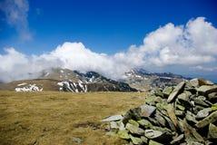 Parang mountains, Romania. Mountain ridge in clouds. Stock Photo