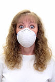 A Paranoid Caucasian woman wears a protective mask. A Paranoid Caucasian woman wearing a protective mask with a scared look on her face. She's afraid of stock images