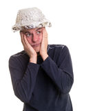 Paranoid Man. A paranoid kooky man wearing a tin foil hat to keep the aliens from reading his thoughts Stock Photography
