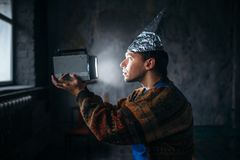Paranoid man in tinfoil cap, mind protection, UFO Royalty Free Stock Images