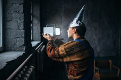 Paranoid man in tinfoil cap, mind protection, UFO Royalty Free Stock Image