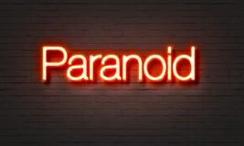 Paranoid neontecken på bakgrund för tegelstenvägg stock illustrationer