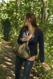 Paranoid woman in forest Stock Photo