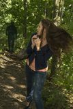 Paranoid woman in forest. Outdoor Shot Stock Images