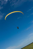 Parapente. Yellow parapente and blue sky Stock Images