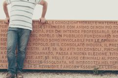 Parapet on the Parco del Gianicolo. Janiculum hill, Rome. above the entire text of the 1849 Roman Constitution. man body Stock Images