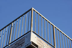 Parapet railing with background blue sky. Metal parapet railing with background blue sky Royalty Free Stock Photo
