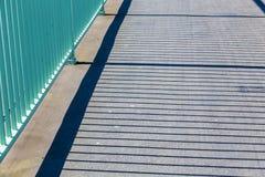Parapet throws shadows on the bridge Stock Photo