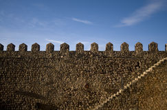 Parapet walk of a fortress. Stairway and merlons. Royalty Free Stock Photo