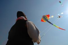 Paraplane. A man Playing with 2 thread paperplane in blue sky Royalty Free Stock Images