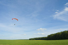 Paraplane. Beautiful summer landscape with motor-powered paraplane flying in the sky royalty free stock images