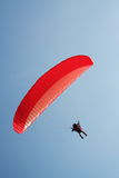 Paraplane. A paraplaner gliding on the blue sky. Extreme sport Stock Image