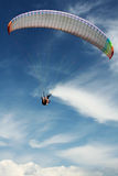 Paraplane. A paraplaner gliding on the blue sky. Extreme sport Royalty Free Stock Images