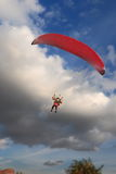 Paraplane in action. Paraplane moves against the evening cloudy sky Royalty Free Stock Images