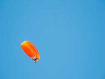 Paraplane in a blue sky. Bottom view Stock Image