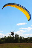 Paraplane. In the blue sky against the forest Stock Photography