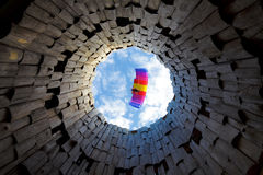 Paraplane in a blue sky. Bottom view through wood tower Royalty Free Stock Photography