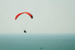 Paraplane fligh over the sea Stock Images