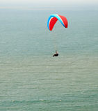 Paraplane flight over the sea Stock Photography