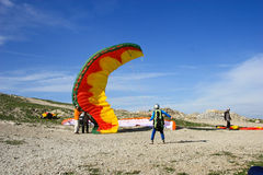 Paraplane Flyer under the Seven Winds mount Royalty Free Stock Image