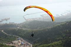 Paraplane Flyer under the Seven Winds mount Royalty Free Stock Images
