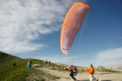 Paraplane Flyer under the Seven Winds mount Royalty Free Stock Photo