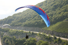 Paraplane Flyer under the Seven Winds mount Royalty Free Stock Photography