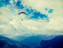 Paraplane in sky above mountains Stock Photography