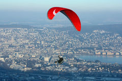 Paraplane in the Sky over Zurich. A red paraplane in the sky flying over Zurich Stock Images