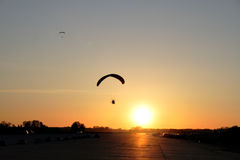 Paraplane on sunset background Stock Photography