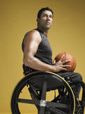Paraplegic Athlete With Basketball In Wheelchair Stock Photography