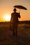 Paraplu in zonsondergang 2 Stock Afbeeldingen