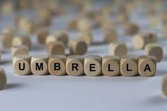 Parapluie - cube avec des lettres, signe avec les cubes en bois Images stock