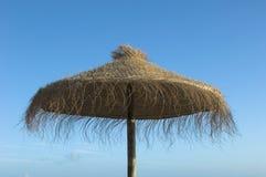 Parapluie de paille Image libre de droits