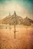 Parapluie de plage d'herbe de texture de vintage Images libres de droits