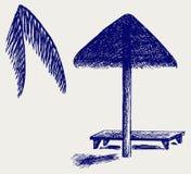 Parapluie de plage en feuille de palmier Images libres de droits